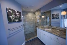 Same granite top used in both bathroom. Using different colors and materials gives the bathrooms a different feel