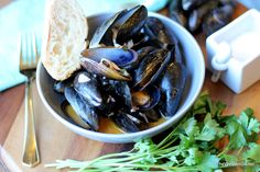 Mussels in White Wine Sauce with Smoked Paprika and Crusty French Bread - thewoodenskillet.com