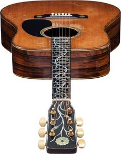 A 1972 David Russell Young Dreadnought acoustic guitar, owned and played by Gram Parsons.: