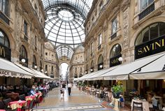 Savini, 02-7200-3433  Galleria Vittorio Emanuele II  Why go: Since 1884, its location within the spectacular Galleria is almost reason enough to make Savini a must-go, but its cuisine, once dated, has become very refined and ideal for before or after viewing a performance at La Scala.  What to eat: Spaghetti in a duck ragu and white truffles  Take note: Attached to Savini is the less expensive Café Bistrot and gelateria serving excellent coffee, pastries and pizza.