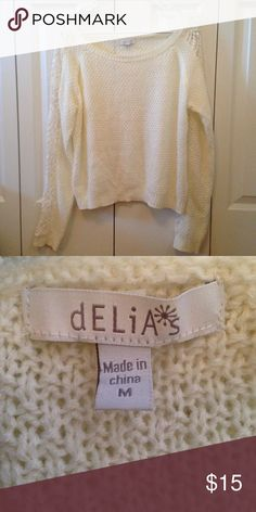 White Cold Shoulder Side Lace Sweater Beautiful sweater with intricate lace pattern along both sleeves. Worn a few times but still in good condition. Perfect for the holiday season! 🎄☃️🎅🏻 Delia's Sweaters