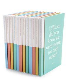 "These are the original guest books I saw from Martha Stewart Wedding: ""Each dinner table bears a blank book with a question on the cover, and each guest finds a pen and ribbon reading ""Don't forget to sign the booklet"" atop the napkin. @Victoria Barber Garretson"