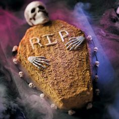 """Coffin Pumpkin Cake Recipe ,,, The maple flavoring in the frosting makes this spooky cake taste delicious! And the gingersnap crumbs make the """"coffin"""" look like a pine box…to suit the season perfectly."""