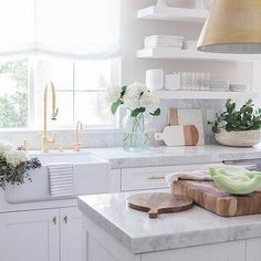 White and Gray Kitchen with Stacked White Floating Shelves