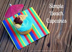 Easy Beach Cupcakes - blue frosting, graham cracker sand, fruit roll-up towel, Teddy Graham sun bather, and drink umbrella!