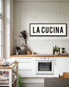 """A warm and rustic kitchen sign, La Cucina (""""the kitchen"""" in Italian) brings a bit of the Tuscan countryside to your home. Inspired by vintage advertising signs, my stretched canvas pieces are handmade"""