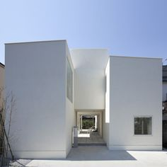 Portico by Aida Atelier and Kuno Lab  This Tokyo house by Japanese architects Aida Atelier comprises a cluster of four white-rendered blocks that support an elevated  fifth block above a central patio.