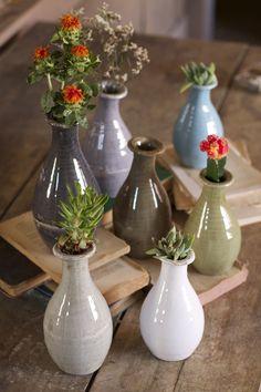set of 7 ceramic bud vases-one each color