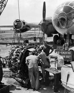 Ground crewmen tune up one of the B-29's four engines prior to reinstallation. The huge bomber was the first to have a pressurized cabin for its flight crew.