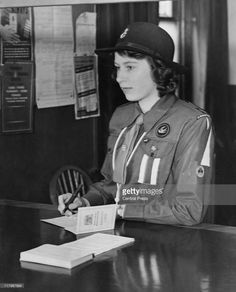 A 16-year-old Princess Elizabeth registers for war service under the Ministry of Labour's Youth Registration Scheme, 25th April 1942. She is wearing her Girl Guide uniform.