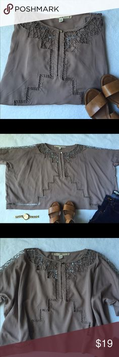 Chelsea & Violet   Aztec Top Flowy, poncho-style top from Chelsea & Violet. Purchased at Dillards. It has cutouts on the sleeves, the front and the back and is perfect for summer and fall. It looks wide in the photo, but it is meant to be flowy. I paired it with dark skinny jeans and heels. Chelsea & Violet Tops