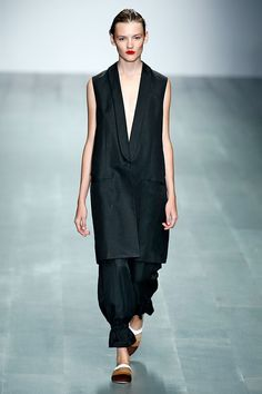 London Fashion Week's Top 10 Trends #refinery29  http://www.refinery29.com/2014/09/74753/london-fashion-week-trends-2014#slide19  Vest DressesThe ultimate two-for-one? A dress with a vest closure — or a vest you can wear as a dress. We're totally crushing on this masculine-meets-feminine silhouette. Eudon Choi