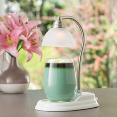 The new white nickel Aurora Candle Warmer lamp. Gives warming candles a classy twist!