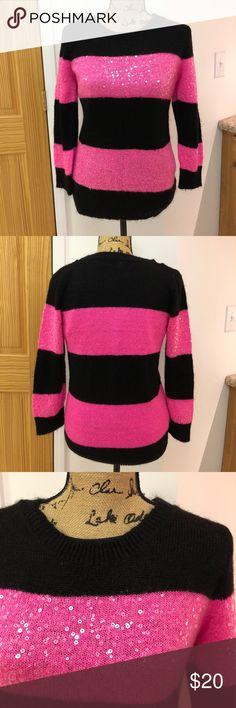Poof sweater with sequins in black and pink Beautiful sequined sweater by Poof. This beautiful sweater has sequins, on the pink stripes, in the front and on the arms only, none on the back. Size is an XL, but it fits like a large. Smoke free home. No trades. Poof! Sweaters Crew & Scoop Necks