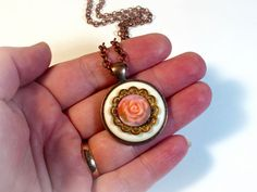 Handmade button necklaces - Repurposed, recycled, upcycled  - One of a kind; not mass produced  - Handmade by artist  https://www.etsy.com/listing/248533933/peach-flower-necklace-pendant-vintage?ref=shop_home_active_7