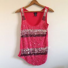 HP Pink tank-top with sequins Rue 21 pink tank-top striped with black and silver sequins. Perfect for a New Year's celebration.  size medium, bundle to save! Rue 21 Tops Tank Tops