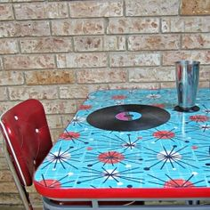Don't paint it!  Update an old table with fabric and epoxy resin.