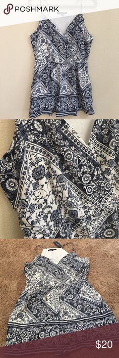 Blue and white floral romper! NEW One Love Clothing floral romper with pockets. Snap closure front and zipper on side. Never been worn. It's a junior large but runs a bit small. one clothing Pants Jumpsuits & Rompers