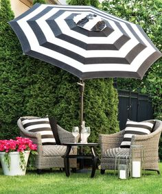 Create your own backyard oasis with this 3-piece wicker conversation set. Accessorize with water-resistant cushions and a matching umbrella that can weather any climate!