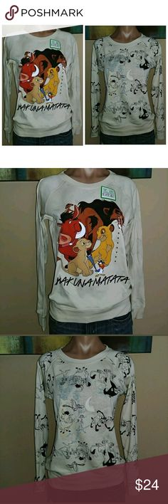 """THE LION KING HAKUNA MATATA REVERSIBLE SWEATSHIRT THE LION KING HAKUNA MATATA REVERSIBLE MOVIE SMALL TOP SWEATSHIRT SHIRT. New with tags. Measurements are approx.: Armpit to armpit: 19"""" and stretches to 24"""" Top to bottom(entire length): 24""""  Materials are: 40% Polyester & 60% Cotton Disney Tops Sweatshirts & Hoodies"""