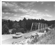 The old Abol Bridge, crossing the West branch of the Penobscot. It has since been rebuilt. Appalachian trail hikers cross this bridge, and it is only a few more miles to the terminus of the trail at the peak of Mt Katahdin. This bridge is a favorite spot of tourists for photographing the mountain.