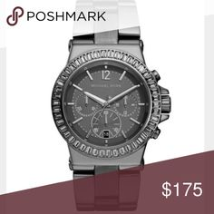 Michael Kors Gunmetal Watch Perfect condition, Mid-size Gunmetal Grey Stainless Steel Dylan Chronograph Glitz Michael Kors watch. 39mm. Black Swarovski crystal accents around face. Water resistant up to 10 ATM. Michael Kors Accessories Watches