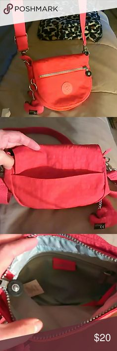 Kipling red mini cross body bag In excellent condition no damages at all red Kipling mini cross body bag has back pocket adjustable detachable cross body strap comes with a red sophie monkey keychain Has a front flap zippered closure under flap and the interior is light tan colored also has a zippered interior pocket great small everyday bag size is 8 length 6 height and 1 depth Kipling Bags Crossbody Bags