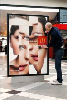 Creative and Cool Interactive Advertisements. People love puzzles. They also think that they can be The person to accomplish it because people love the feeling of winning. This interactive placement would be perfect in a mall or at an airport for people to work on if they are waiting for someone to finish shopping or if they are waiting for their flight.