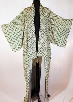 Vintage, one of a kind, silk kimono from Japan. This kimono sweeps the floor. Geometrically gorgeous and ready to rock, this kimono with its subtle green tones can go with your favorite blue jeans or any other staple
