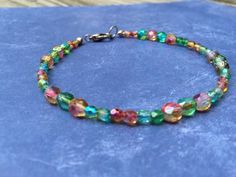 A personal favorite from my Etsy shop https://www.etsy.com/listing/246341394/green-orange-and-gold-czech-glass-beaded