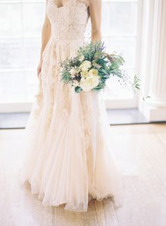 Blush wedding dress by Reem Acra, image by Jessica Lorren Photography. Bouquet by Jessica Sloane Event Styling & Design. See more in the Spring 2014 issue of Weddings Unveiled.