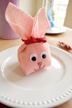 Fold these easy little easter bunny in less than 15 minutes! No sewing, just fold and hot glue the eyes and bunny face.