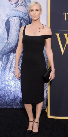 Charlize Theron stunned at The Huntsman: Winter's War premiere in a black Dior Haute Couture creation with one off-shoulder strap and a sheer illusion one embroidered with embellishment. The finishing touches? Harry Winston diamonds, a black clutch, and Louboutin pumps.