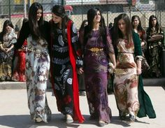 Iraqi students wearing traditional Kurdish clothing in the northern Iraqi city of Irbil celebrate International Women's Day.