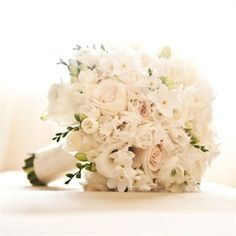 White Bridal Bouquet with lots of texture.   freesia, roses, stephanotis