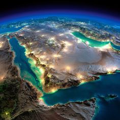 Highly detailed Earth illuminated by moonlight over Saudi Arabia.  The glow of cities sheds light on the detailed terrain.