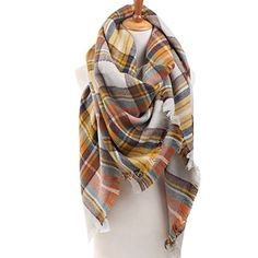 Get cozy with a big blanket scarf this season! Here are a few cool ways to style your outfits with the warmest trend going.
