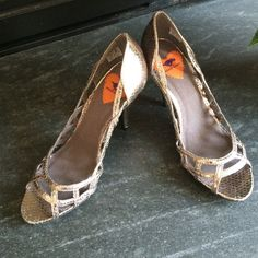 Metallic High Heels Metallic peep toe heels soft gold color by rocket dog. Excellent condition. I don't think they've ever been worn. Rocket Dog Shoes Heels