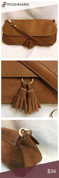 """Talbots Kelsey Leather Suede Tassel Chestnut Bag Talbots Kelsey Leather Suede Tassel Bag Purse Chestnut Brown • Cobblestone texture leather on flap, corners, bottom, and strap  • Front and back panels are suede • Strap is 20"""" long and removable • Two suede tassels • Lined interior has two patch pockets and one zippered pockets • Gold Hardware • 12.5""""x7.5""""x4""""  • Very good preloved condition, An imperfection on the back of the flap is pictured. Talbots Bags Shoulder Bags"""