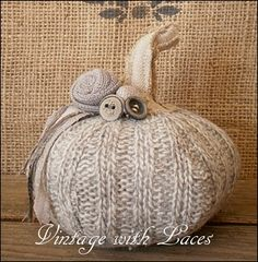 Recycle sweaters into cute Wool Pumpkins! Embellish them with buttons, ribbons and a stem. How cute!