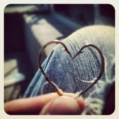 Fishin hooks... super cute with a ring inside the heart for an engagement pic