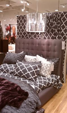 Bedding I like.  Z Gallery, I think. Like the curtains behind the bed too.