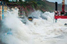 Wind whips up storm waves crashing over the railway in Dawlish, Devon in 2014
