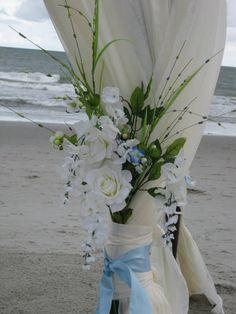 Lovin it.. Beach wedding chuppah flowers.. add some blue and orange, perfect