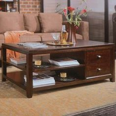 "Coffee table with 2 drawers and open shelving.   Product: Coffee tableConstruction Material: Cherry woodColor: Brown and nickelFeatures:  Two drawersTwo shelves Dimensions: 20"" H x 50"" W x 30"" D"