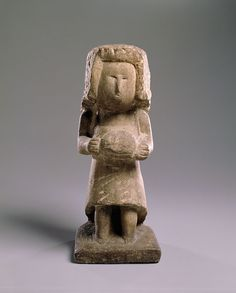 "LADY WITH MUFF/ William Edmondson (1874-1951), c. 1940, limestone, 15 1/2 x 6 1/2 x 6 3/4"", Collection American Folk Art Museum, New York, gift of Ralph Esmerian, 2013.1.54 Photo by Gavin Ashworth"