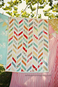 Chevron patchwork quilt-- this is the pattern (width, spacing, direction, angle) I want to use, just with my aqua palette. Quilting Projects, Quilting Designs, Sewing Projects, Fabric Crafts, Sewing Crafts, Diy Crafts, Herringbone Quilt, Photos Booth, Amy Butler