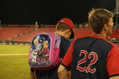 David Griffin dons the Frozen backpack, carried by the last Rox pitcher to allow a home run.