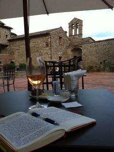 Do you have a favorite #Tuscan moment? (A respite in the piazza at Castel Monastero near #Siena).