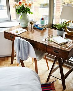 Emily's vintage campaign-style desk in her NYC apartment